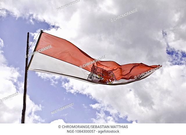 Flag of south tyrol in the wind