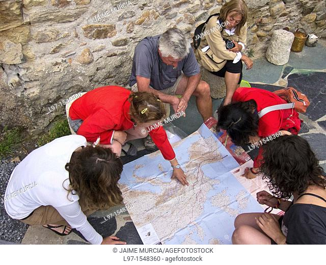 Pilgrims study a map along the Camino de Santiago in the village of Pieros
