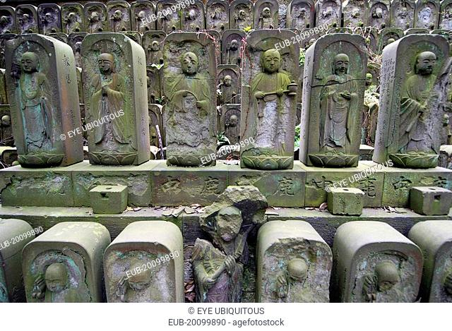 Nippori Jyomo-in shrine dozens of stone Jizo statues of the Buddha