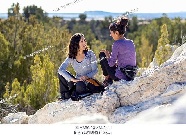 Hikers talking on rocky hilltop
