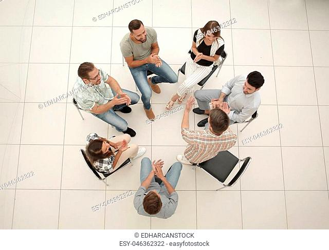 top view.business team discussing interesting ideas.the concept of teamwork