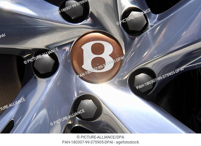 07 March 2018, Switzerland, Geneva: The logo of carmaker Bentley is on display on a wheel rim of an exhibited car during the 2nd Press Day at the 2018 Geneva...