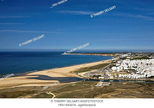 Aerial view of Conil de la Frontera's bay and lighthouse Cádiz area Spain  Arroyo salado river mouth