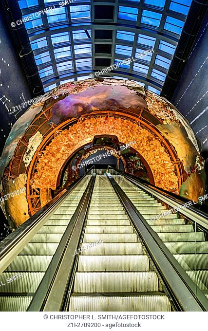 Escalator passing thru Planet Earth in the Natural History Museum, London