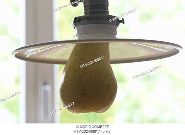 Close-up of pendant light with pear