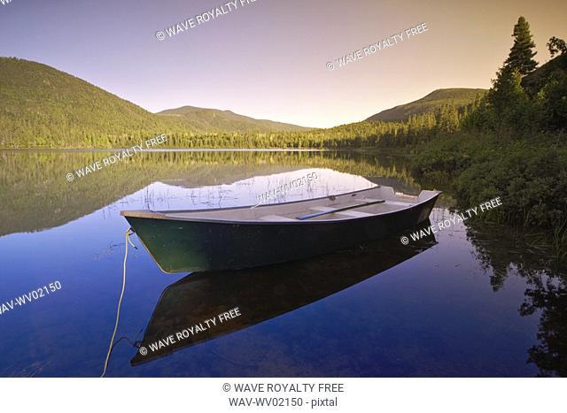 View of boat at Lebreux lake at sunset, Quebec
