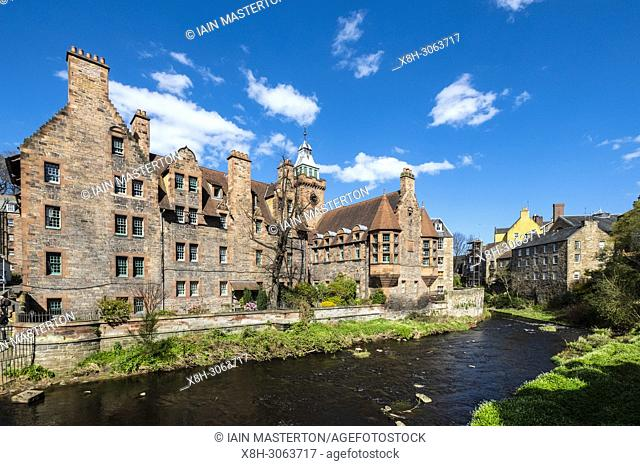 View of Water of Leith river at Dean Village with historic Wells Court building , Edinburgh, Scotland, UK