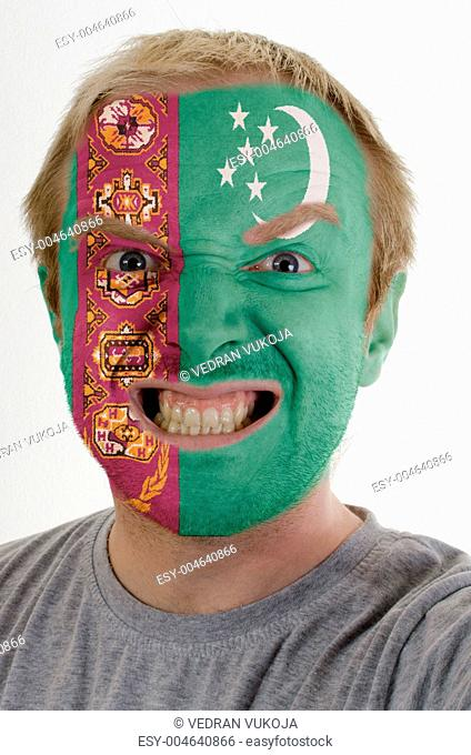Face of crazy angry man painted in colors of Turkmenistan flag