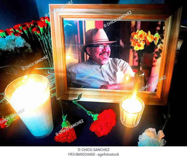 A portrait of killed journalist Javier Valdez decorated with candles in an event to present his work in Colonia Roma, Mexico City, Mexico