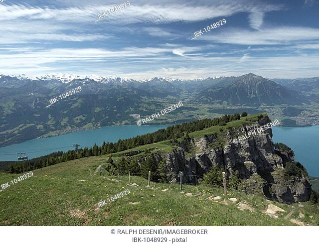 View of the mountain station at Niederhorn with Lake Thun and mountain range of the Bernese Alps, Canton of Bern, Switzerland, Europe