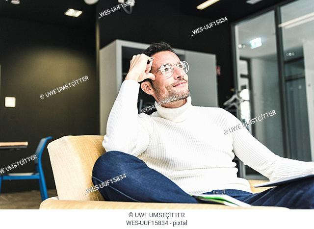 Businessman working relaxed in his office