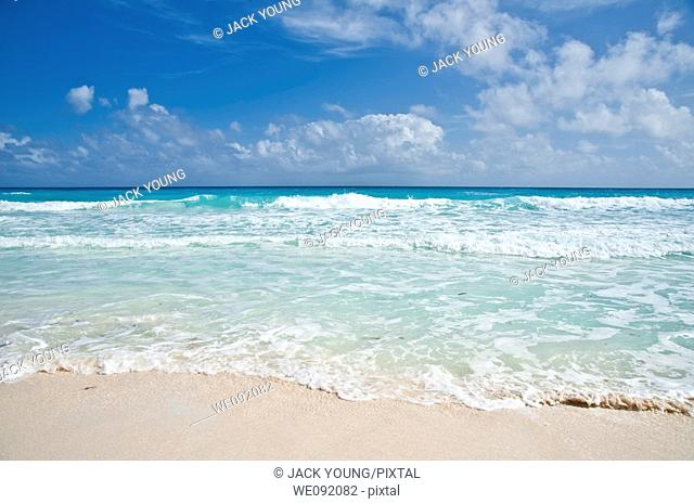 Gentle waves on a white tropical beach