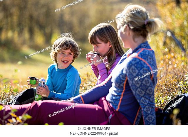 Mother with children resting during hike