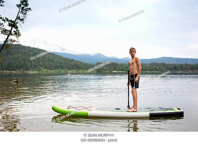 Teenage boy on paddleboard