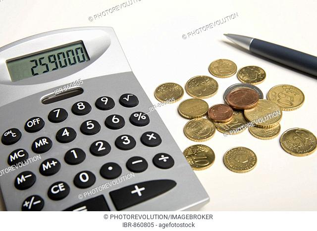 Euro coins and pen next to a calculator
