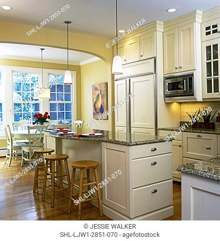 KITCHENS - View towards eating area, white table and chairs, island, cream color cabinetry, traditional styling, beige/tan granite counter tops