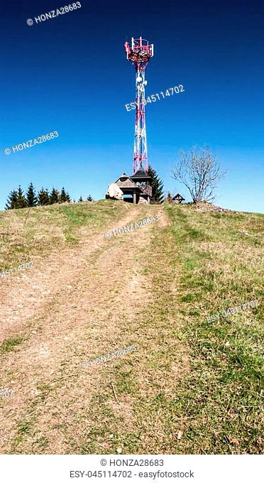 Kamenite hill in Javorniky mountains in Kysuce region in Slovakia with communication tower, small wooden view tower, big stone