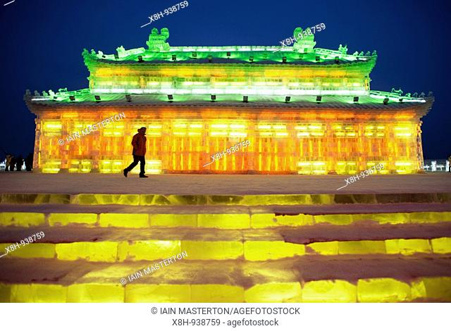 Illuminated temple building carved from ice at the annual Ice Lantern Festival in Harbin northern China