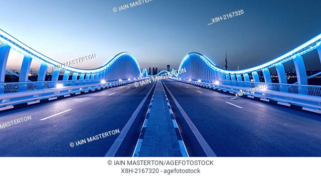 Illuminated architectural bridge at Meydan in Dubai United Arab Emirates