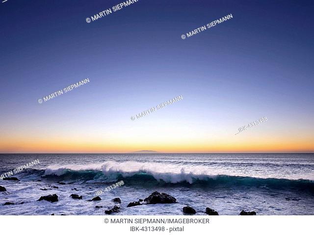 Ocean wave, surf, dusk, island of El Hierro behind, Valle Gran Rey, La Gomera, Canary Islands, Spain