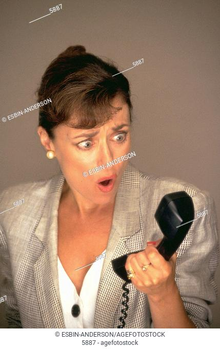Annoyed business woman on phone