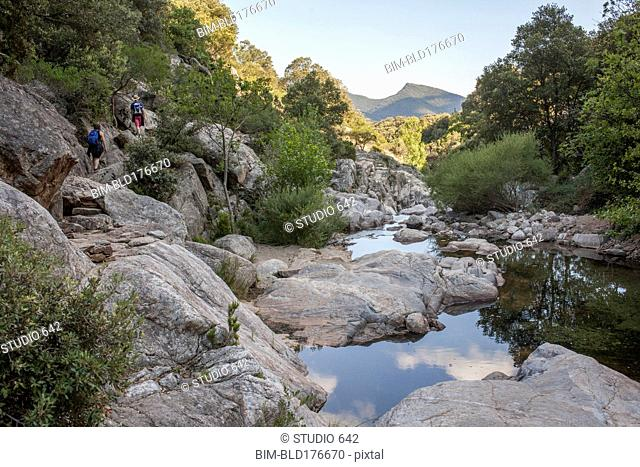 Still river over rocks in remote forest