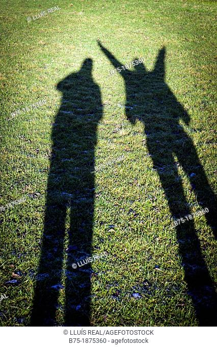 Shadow of two people in the field