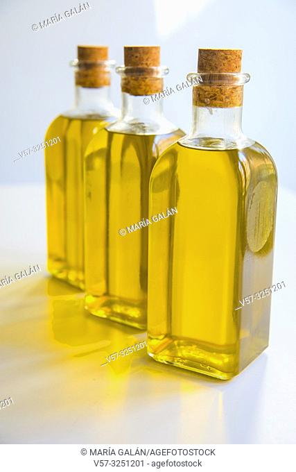 Three oil bottles with olive oil. Spain