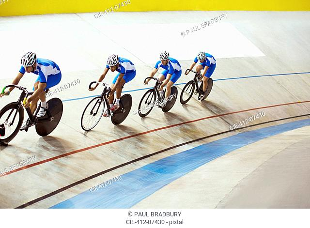 Track cycling team riding in velodrome