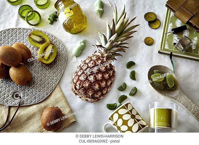 Green colored still life with pineapple and kiwi fruit