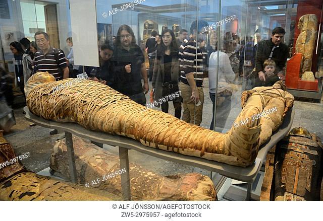 Visitors look at Egyptian mummies in British Museum, London, UK