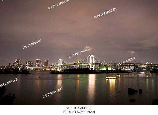 Cityscape of Rainbow bridge and Tokyo Bay at night, Tokyo, Japan