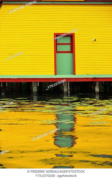 Yellow house, Rio Dulce, Guatemala, Central America