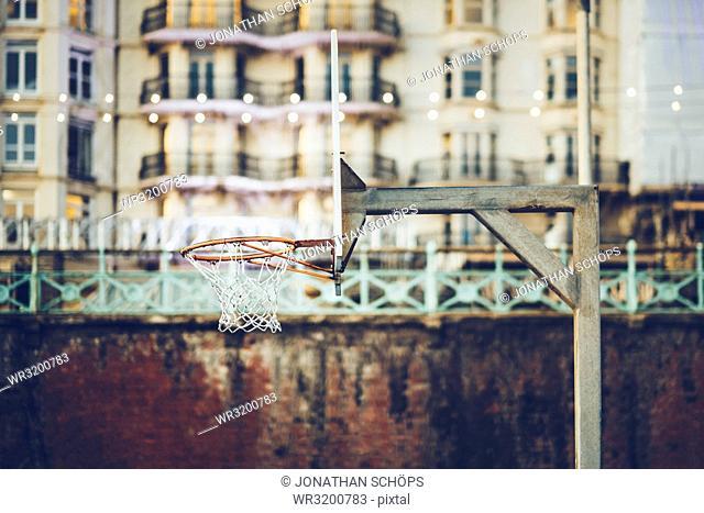 Basketball hoop on beach promenade, Brighton, England