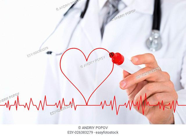 Close-up Of Male Doctor Hand Drawing A Heart Symbol Near Electrocardiogram With Red Marker