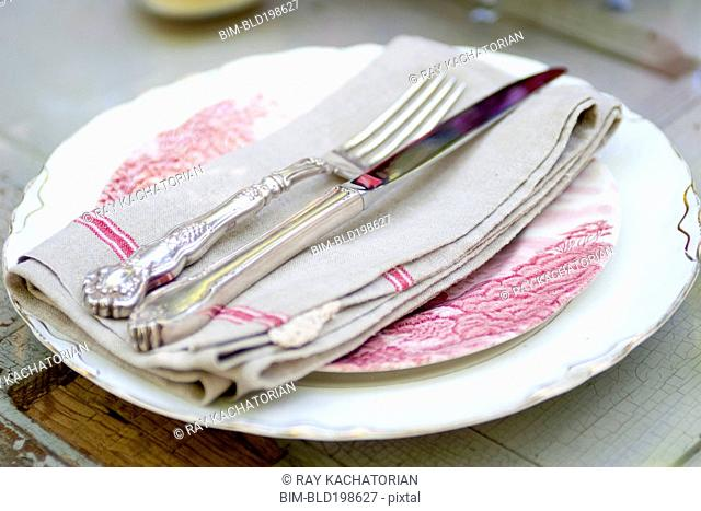 Silverware and napkin on plate