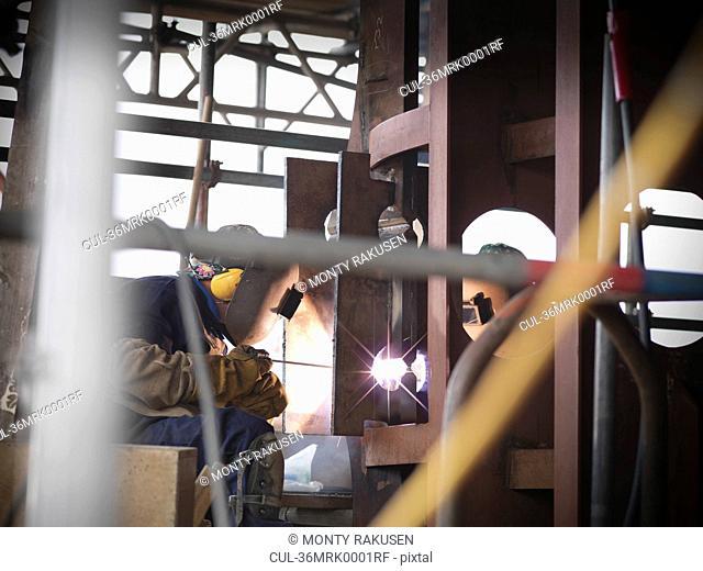Welders at work building ship