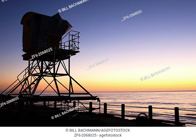 San Diego California CA La Jolla sunset at The Cove with beach and lifeguard stand with beach at twilight