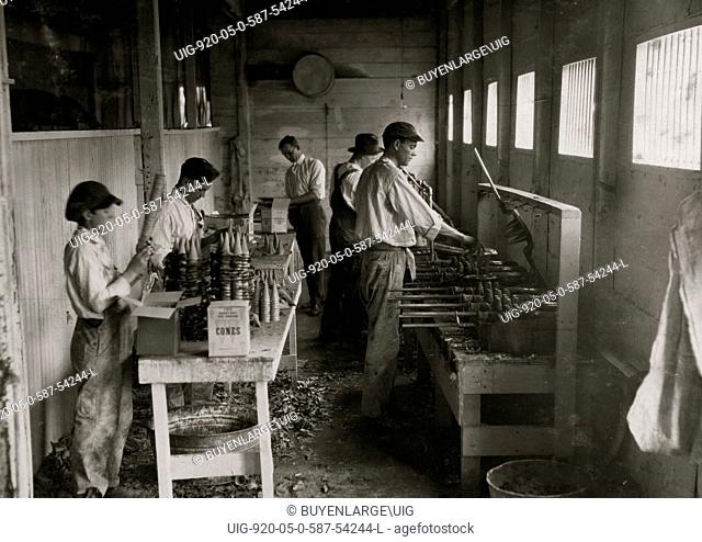 Interior of workshop of Sanitary Ice Cream Cone Co. Boys packing cones are John Myers, 14 years old and a boy 12 years old who is working steady now