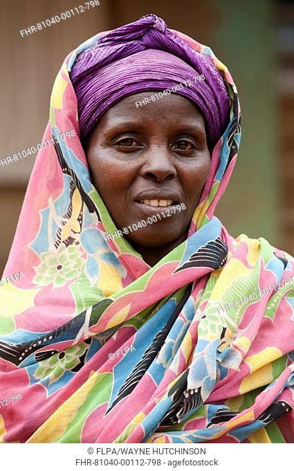 Muslim lady with brightly coloured head scarf, close-up of head, Rwanda