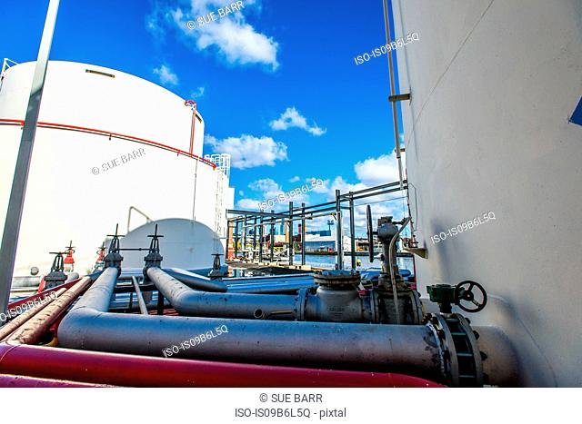 Storage tanks and industrial piping at biofuel plant