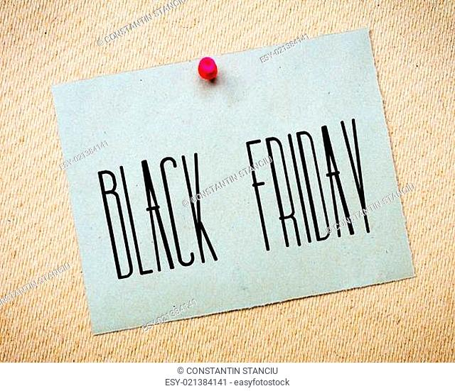 Recycled paper note pinned on cork board.Black Friday Message. Concept Image