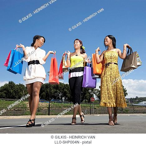 Low angle view of women holding shopping bags, KwaZulu Natal Province, South Africa
