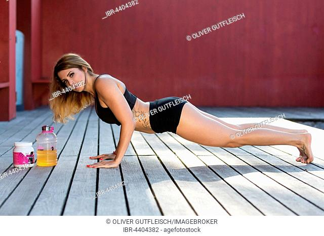 Young woman poses in sporty black two-piece set