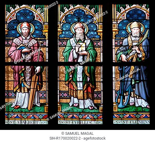 Stained Glass Window depicting from left to right St. Adalbert, St. Cybillus and St. Clemens