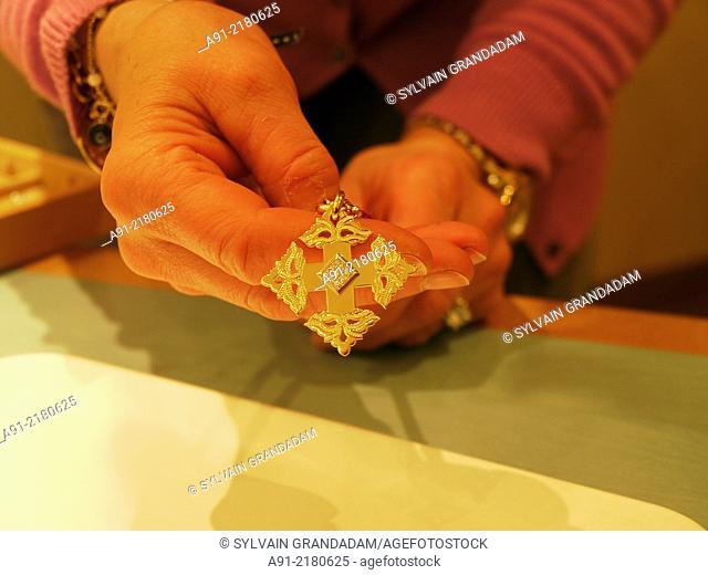 France, Haute-Savoie, Megeve in winter, famous jewelry a gold cross