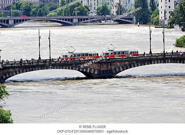 A tram crosses Legion Bridge in center of Prague as flooded Vltava river culminated in Prague, Czech Republic, on Tuesday, June 4rd, 2013