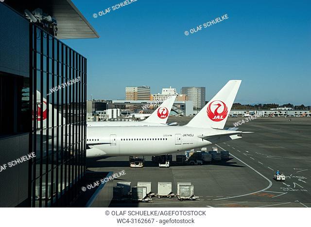 02. 01. 2018, Tokyo, Japan, Asia - Japan Airlines passenger planes are seen parked at their gates at Tokyo's International Airport Narita