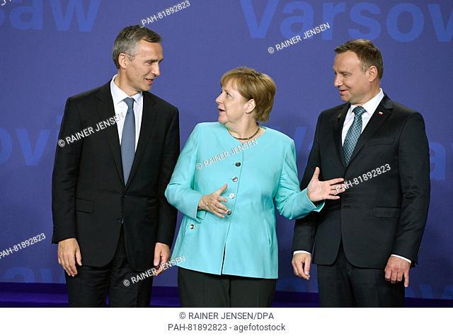 German Chancellor Angela Merkel (CDU, c), Nato General Secretary Jens Stoltenberg (l)and Polish President Andrzej Duda posing during a group photo at the...