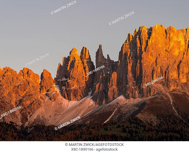 Rosengarten also called Catinaccio mountain range in the Dolomites of South Tyrol Alto Adige during autumn  Sunset with alpenglow  The Rosengarten is part of...